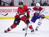 Ottawa Senators defenceman Dylan DeMelo (2) moves the puck away from Montreal Canadiens left wing Paul Byron (41) during second period NHL hockey action in Ottawa on Thursday, Dec. 6, 2018. THE CANADIAN PRESS/Sean Kilpatrick ORG XMIT: SKP109