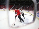 Matt Duchene, left, and Thomas Chabot are seen here during the Senators' skate at Canadian Tire Centre on Tuesday.