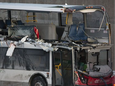 The OC Transpo bus involved in Friday's crash at Westboro Station was towed from the scene, revealing extensive damage, on Jan. 12, 2019.