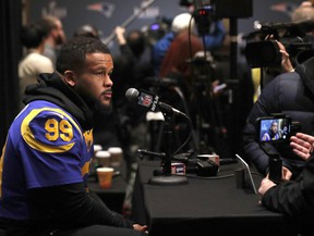 Los Angeles Rams defensive end Aaron Donald speaks to reporters during a media availability ahead of the NFL Super Bowl 53 football game against the New England Patriots Wednesday, Jan. 30, 2019, in Atlanta. (AP Photo/John Bazemore)