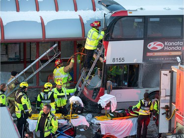 First responders attend to victims of a horrific rush hour bus crash at the Westboro Station near Tunney's Pasture.