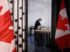 Post office worker Angèle Ouellet takes a few quiet moments to view the Books of Remembrance in their new home in West Block at Parliament Hill, which opened Tuesday (Feb. 5, 2019).  The books, which carry the names of every Canadian soldier that lost their lives from World War I to today, were moved from the Peace Tower to a newly created room in West Block while Centre Block undergoes renovations for the next several years.  Julie Oliver/Postmedia