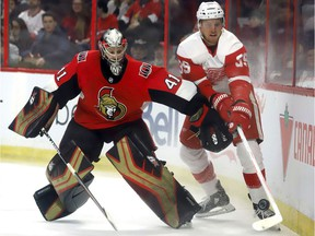 Senators goaltender Craig Anderson (41) battles for the puck behind his net against Red Wings forward Anthony Mantha during Saturday's game at Canadian Tire Centre.