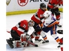 Ottawa Senators goaltender Anders Nilsson (31) covers the puck as Ottawa Senators defenceman Christian Wolanin (86) and New York Islanders centre Valtteri Filppula (51) battle during second period NHL hockey action in Ottawa on Thursday, March 7, 2019. THE CANADIAN PRESS/Fred Chartrand ORG XMIT: FXC209
