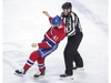 Montreal Canadiens left wing Paul Byron (41) is helped off the ice by lineman Michel Cormier after his fight with Florida Panthers defenceman MacKenzie Weegar (52) during first period NHL hockey action Tuesday, March 26, 2019 in Montreal. THE CANADIAN PRESS/Ryan Remiorz ORG XMIT: RYR106