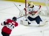 Ottawa Senators centre Colin White fires the puck wide of the net past Florida Panthers goaltender Roberto Luongo during second period NHL action Thursday March 28, 2019 in Ottawa. THE CANADIAN PRESS/Adrian Wyld ORG XMIT: ajw105