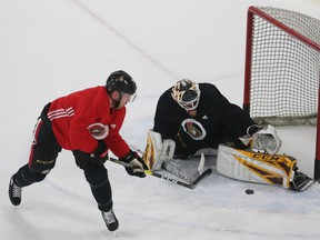 Senators forward Mikkel Boedker gets stopped by goalie Joey Daccord during a drill at Senators practice on Tuesday.