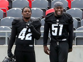 Linebacker Shaheed Salmon (51) shares a laugh with linebacker Avery Williams during Ottawa Redblacks training camp at TD Place on Wednesday, May 29, 2019. Julie Oliver/Postmedia