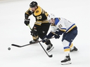 Brad Marchand, right, of the Bruins and Tyler Bozak of the Blues battle for the puck during the third period in Game 5 on Thursday night.