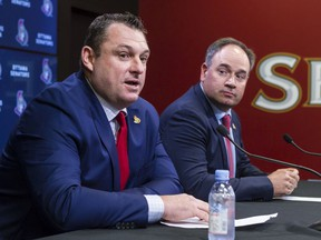 General manager Pierre Dorion, seen here with new head coach D.J. Smith during a media conference in May, says the Senators will get a player who will play in the NHL eventually with the No. 19 pick in the draft on Friday night.