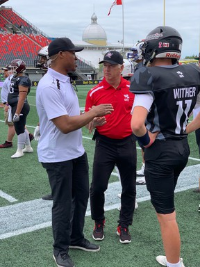 Team Burris coach Henry Burris and Team Dunigan coach Matt Dunigan chat during Saturday's CanadaFootballChat.com Prospects Game at TD Place.(SUPPLIED GAME)