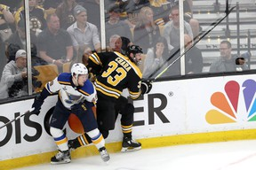 Blues' Ivan Barbashev gets tangled up with Bruins' Zdeno Chara earlier in the Stanley Cup final. Barbashev will sit out Game 6 for his illegal hit in Game 6.(GETTY IMAGES)