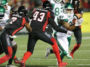 Jonathan Newsome (43) tries to cut off the angle on the Saskatchewan Roughriders' Marcus Thigpen during the second half of a CFL regular-season game at TD Place stadium earlier this season.