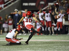 CP-Web.  Calgary Stampeders kicker Rene Paredes, makes the winning kick as teammate Rob Maver holds the ball during second half CFL action against the Ottawa Redblacks in Ottawa on Thursday, July 25, 2019. The Stamps took the Redblacks 17-16.