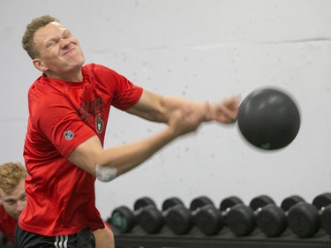 Brady Tkachuk throws a medicine ball as the Ottawa Senators begin training camp with medicals and fitness testing