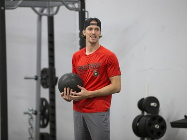 Thomas Chabot prepares to throw a medicine ball as the Ottawa Senators begin training camp with medicals and fitness testing.