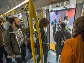 Passengers get off the train at Tunney's Pasture while others wait to get on as the LRT is seen in operation on day 2 of the system up and running.