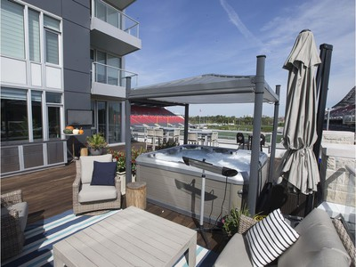 Jeff Hunt, co-owner of the Ottawa Redblacks, is selling his luxurious condo that overlooks TD Place. The outdoor living space and hot tub.