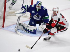 Ottawa Senators forward Filip Chlapik reaches for the puck against Vancouver Canucks goaltender Thatcher Demko during the second period at Rogers Arena on Sept. 25, 2019.