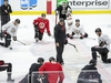 Head coach D.J. Smith talks to the players at the end of practice as the Ottawa Senators practice at Canadian Tire Centre in advance of their season opener against the Leafs in Toronto. Photo by Wayne Cuddington/Postmedia