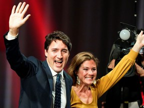 Liberal leader and Canadian Prime Minister Justin Trudeau and his wife Sophie Gregoire Trudeau wave on stage after the federal election at the Palais des Congres in Montreal, Quebec, Canada October 22, 2019.