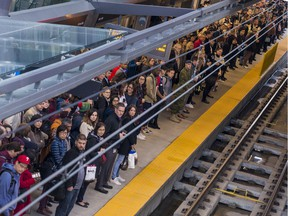 Commuters at the Tunney's Pasture Station await their train on Monday October 7, 2019.