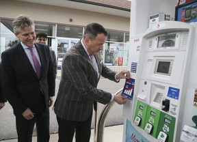 Rob Phillips, Minster of the Environment, Conservation and Parks, (L) and Greg Rickford, Minster of Energy, Northern Development and Mines, with an example of the sticker that will be placed on the pumps for participating gas stations was unveiled during a press conference on carbon tax for home heating and gas on April 8, 2019. (Veronica Henri/Toronto Sun)
