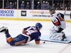 NEW YORK, NEW YORK - NOVEMBER 05:  Cole Bardreau #34 of the New York Islanders is tripped while shooting against Craig Anderson #41 of the Ottawa Senators during their game at Barclays Center on November 05, 2019 in New York City. (Photo by Al Bello/Getty Images)