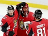 Thomas Chabot (L) and Ron Hainsey congratulate Anders Nilsson on the win at the end of the game as the Ottawa Senators take on the Carolina Hurricanes in NHL action at the Canadian Tire Centre in Ottawa. Photo by Wayne Cuddington / Postmedia