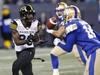 Hamilton Tiger-Cats' Bralon Addison (86) catches the pass against the Winnipeg Blue Bombers during the first half of CFL action in Winnipeg on Friday, September 27, 2019. THE CANADIAN PRESS/John Woods ORG XMIT: JGW105