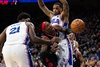 Raptors forward Rondae Hollis-Jefferson (4) looses control of the ball while driving against Philadelphia 76ers centre Joel Embiid (21) and guard Josh Richardson (0) during the first quarter at Wells Fargo Center. : Bill Streicher-USA TODAY Sports