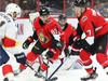 Craig Anderson of the Ottawa Senators follows the puck as it slips through Christian Jaros and Brady Tkachuk (R) and eventually past him for a goal by the Florida Panthers during second period of NHL action at Canadian Tire Centre in Ottawa, January 02, 2020.  Photo by Jean Levac/Postmedia News assignment 132961