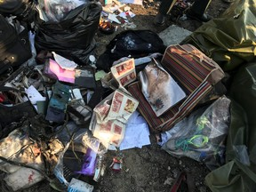 Passengers' belongings are seen after the Ukraine International Airlines plane crashed after take-off from Iran's Imam Khomeini airport, on the outskirts of Tehran, Iran Jan. 8, 2020. (Nazanin Tabatabaee/West Asia News Agency via REUTERS)