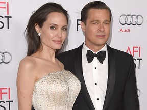 """In this Nov. 5, 2015, file photo, Angelina Jolie (L) and Brad Pitt attend the opening night gala premiere of Universal Pictures' """"By the Sea,"""" during AFI FEST 2015 presented by Audi at TCL Chinese 6 Theatres on in Hollywood, Calif."""