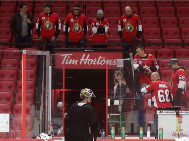 Participants of the Soldier On event at the Canadian Tire Centre look at Marcus Högberg exiting the ice in Ottawa, February 03, 2020.  In partnership with the Canadian Forces' Soldier On Program, the Senators Alumni will host a two-day camp at Canadian Tire Centre in support of ill and injured veterans beginning Monday morning. On Monday, Feb. 3, a group of ill and injured veterans from the Canadian Forces (CF) Soldier On Program will arrive at Canadian Tire Centre for a two-day camp with the Senators Alumni.  Photo by Jean Levac/Postmedia News assignment 133187