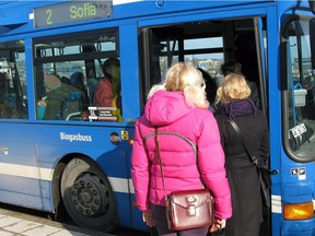 File photo of people boarding a bus in Stockholm, Sweden.