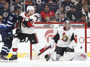 Feb 8, 2020; Winnipeg, Ottawa Senators goaltender Craig Anderson (41) watches the puck in the first period as Ottawa Senators defenseman Ron Hainsey (81) defends and Winnipeg Jets right wing Patrik Laine (29) looks for a rebound at Bell MTS Place.