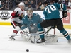 Mar 7, 2020; San Jose, California, USA; The puck rolls away from San Jose Sharks goaltender Aaron Dell (30) and forward Alex True (70) on a deflected shot by Ottawa Senators forward Rudolfs Balcers (38) during the first period at SAP Center at San Jose. Mandatory Credit: D. Ross Cameron-USA TODAY Sports ORG XMIT: USATSI-406046