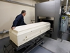 ***Freelance Photo - Postmedia Network use only. - NO SALES. Resale rights remain with  photographer *** MONTREAL, QUEBEC: OCTOBER 23, 2013 -- DAY IN THE LIFE OF DEATH-- Crematorium technician Gilbert Holmes wheels a coffin for cremation at JJ Cardinal Funeral Home in Montreal, October 23, 2013. (Christinne Muschi for National Post)