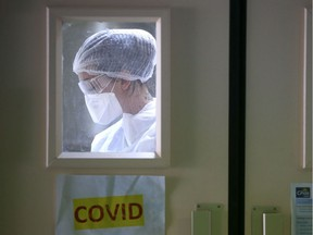 A nurse wearing protective gear is at work in the COVID-19 area.