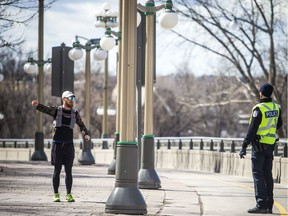 A Gatineau police officer on foot patrol on the Portage Bridge on Saturday orders a jogger to turn around and return back to the Ottawa side of the interprovincial span.