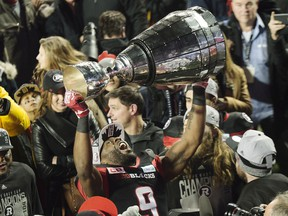 Ottawa Redblacks wide receiver Ernest Jackson lifts the Grey Cup following his team's win against the Calgary Stampeders in overtime CFL Grey Cup football action on Sunday, November 27, 2016 in Toronto.