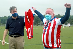 Mayor Jim Watson (left) and Atlético Ottawa's strategic partner, Jeff Hunt,  announce the team's tepid re-entry back to playing.