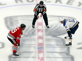 Jonathan Toews (left) of the Chicago Blackhawks and Brayden Schenn of the St. Louis Blues prepare to battle for the opening face-off in an exhibition game prior to the 2020 NHL Stanley Cup Playoffs at Rogers Place on Wednesday in Edmonton, Alberta.