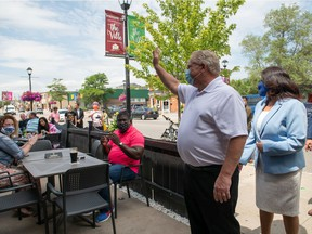 Ontario Premier Doug Ford waves to customers at Cuchulainn's Irish Pub in Mississauga, Ont., on Tuesday, July 21, 2020.
