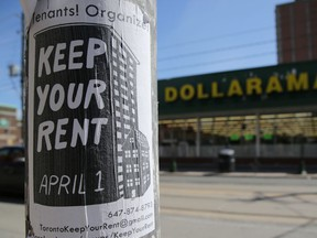 A sign publicizing a rent strike is fixed to a light pole.