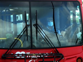 An OC Transpo bus driver wearing a mask.