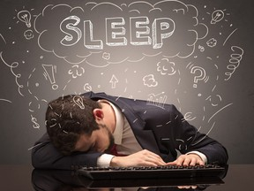 Businessman fell asleep at his workplace with ideas, sleep and tired concept