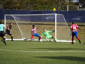 Atlético Ottawa goalkeeper IgnacioZabal Almazán receives assistance from teammates as he defends against a Forge FC attack during Sunday's game in Charlottetown.