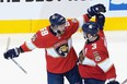 Panthers winger Mike Hoffman, left, celebrates his power-play goal with defenceman Keith Yandle. The Pantehrs beat the Islanders 3-2 on Wednesday to stay alive in their series. GETTY IMAGES